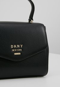 DKNY - WHITNEY SATCHEL - Across body bag - black/gold - 6