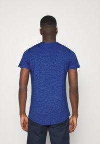 Tommy Jeans - SLIM JASPE C NECK - Jednoduché triko - blue - 2