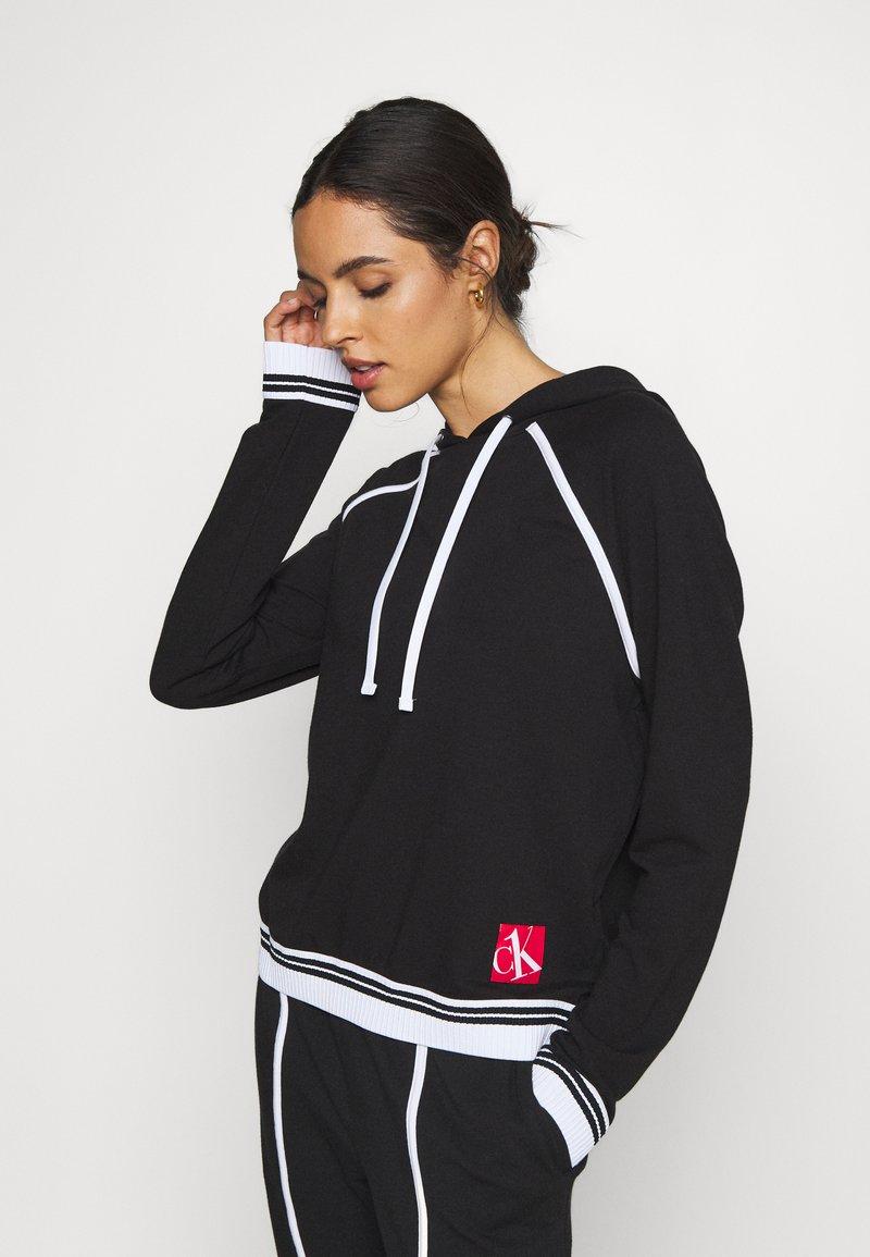 Calvin Klein Underwear - SOCK LOUNGE HOODIE - Pyjama top - black