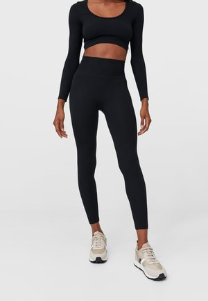 NAHTLOSE - Leggings - Trousers - black