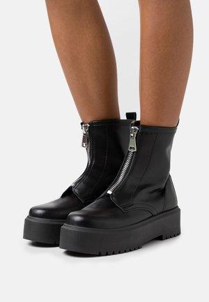 KASPER - Kotníkové boty na platformě - black