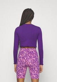 Ellesse - REO - Langærmede T-shirts - purple - 2