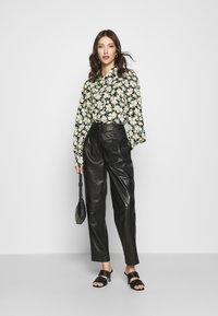 Monki - NALA BLOUSE - Button-down blouse - black dark unique - 1