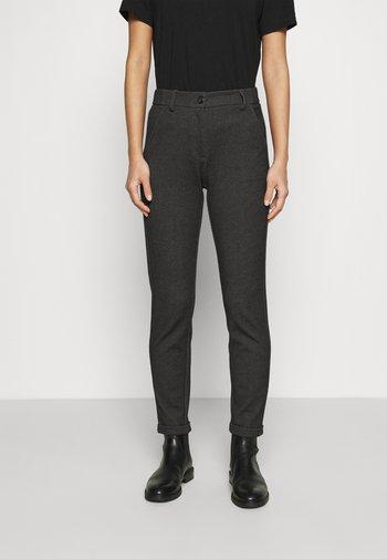 MELINA FRESH - Trousers - black