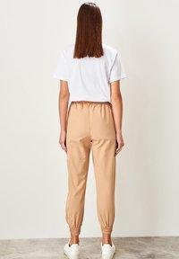Trendyol - Tracksuit bottoms - beige - 2