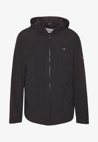 CRINKLE HOODED WINDCHEATER - Summer jacket - black
