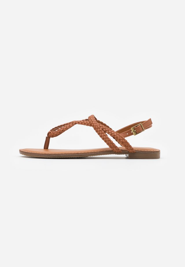 ARIAA - T-bar sandals - cognac paris
