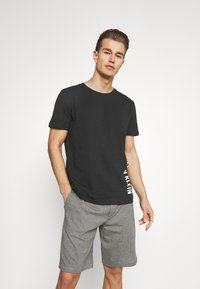 Calvin Klein Swimwear - INTENSE POWER CREW TEE - Undershirt - black - 1