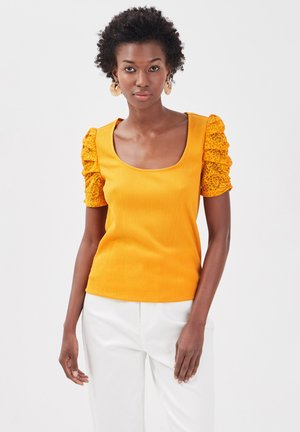 T-shirt med print - jaune foncé