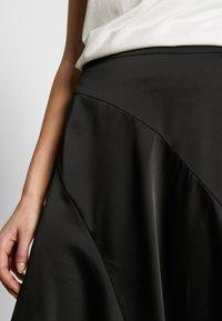 Vero Moda - VMGABBI CALF SKIRT - Áčková sukně - black - 4