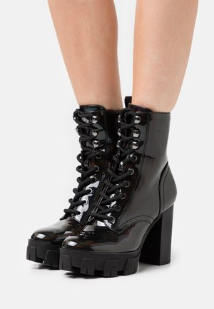 NEESHA - Lace-up ankle boots - black