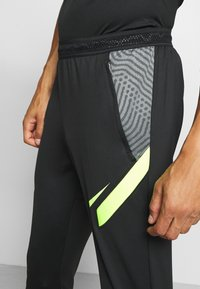 Nike Performance - DRY STRIKE PANT - Tracksuit bottoms - black/smoke grey/black/volt - 5