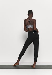 Deha - YOGA PANTS - Tracksuit bottoms - black - 2