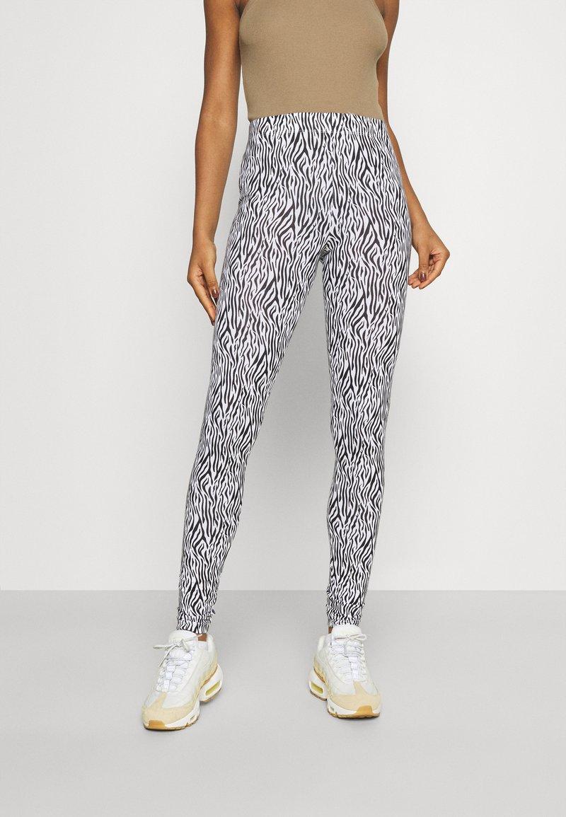 ONLY - ONLBELLA LIVE LOVE - Leggings - Trousers - black/zebra