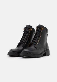 Coach - LORIMER BOOTIE - Lace-up ankle boots - black - 2