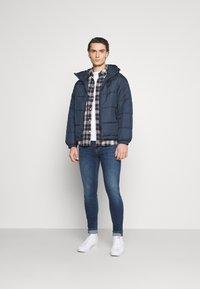 adidas Originals - HOODED PUFF - Vinterjakker - dark blue - 1