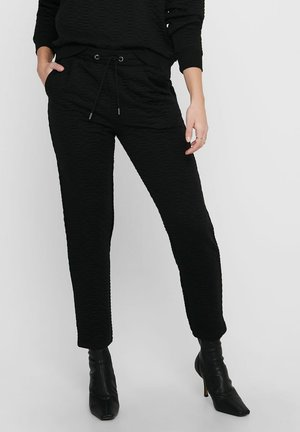 STEPP - Tracksuit bottoms - black