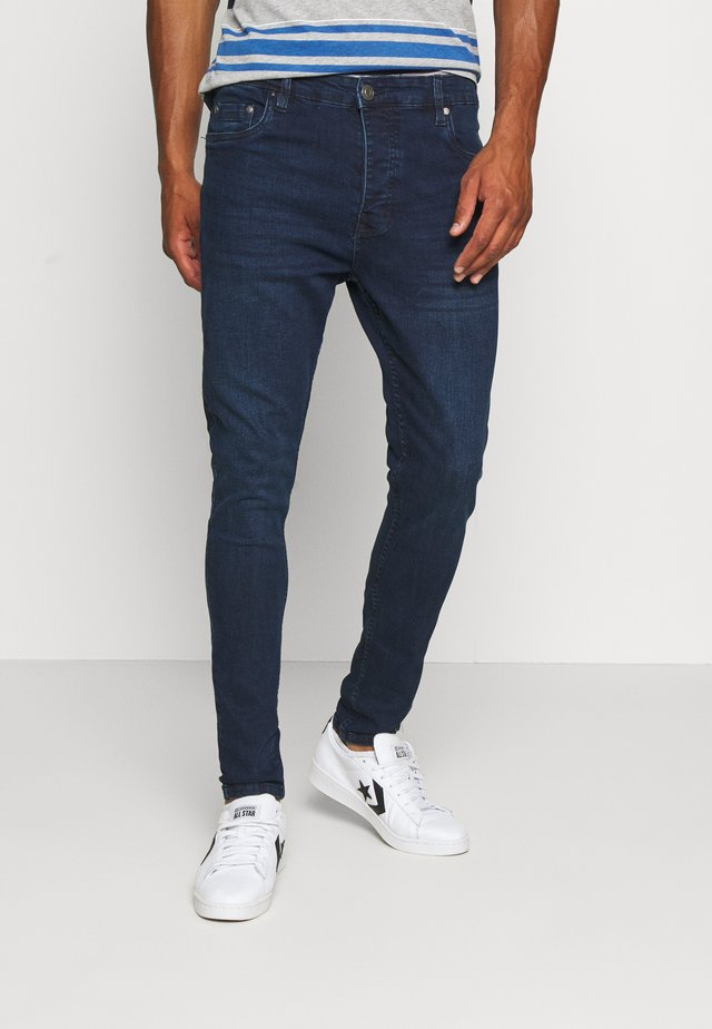 MADISONCHARC - Jeans Tapered Fit - dark blue wash