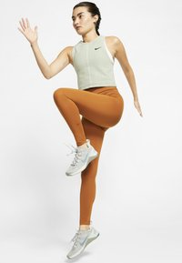 Nike Performance - ONE LUXE - Tights - burnt sienna - 1
