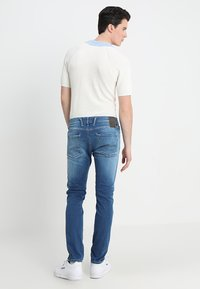 Replay - HYPERFLEX ANBASS - Slim fit jeans - dark blue denim - 2