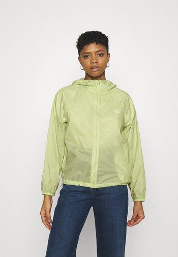 LINA PACKABLE WINDBRKR - Summer jacket - shadow lime