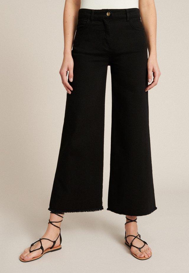 Široké džíny - nero
