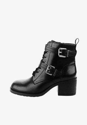 MONTEFALCO - Ankle boots - black