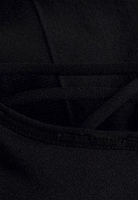 Etam - EMA BRASSIERE - Light support sports bra - noir - 2