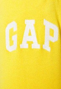 GAP - JOGGER - Tracksuit bottoms - yellow sundown - 2