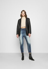 Diesel - FAYZA - Relaxed fit jeans - indigo - 1