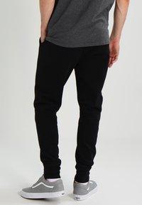 AllSaints - RAVEN - Tracksuit bottoms - black - 2