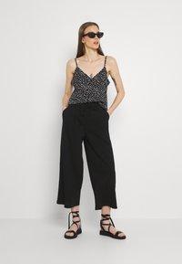 ONLY - ONLKIRAS LIFE CULOTTE PANTS - Trousers - black - 1