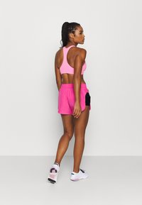 Nike Performance - AIR SHORT - Pantalón corto de deporte - pinksicle/black/black - 2