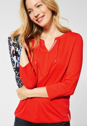 MIT GUMMIZUG - Long sleeved top - orange