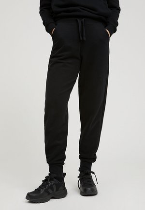 MAAIKA - Tracksuit bottoms - black