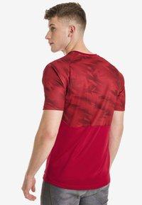 Puma - CUP  - Print T-shirt -  red - 1