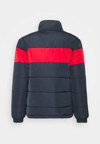 Karl Kani - UNISEX RETRO BLOCK REVERSIBLE PUFFER  - Winter jacket - navy - 1