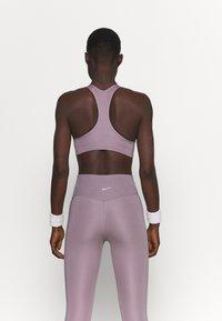 Nike Performance - NON PADDED BRA - Medium support sports bra - purple smoke/white - 2