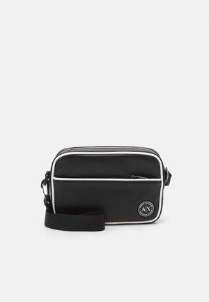 PIPE CROSS BODY BAG UNISEX - Across body bag - black/white