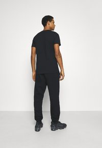 Blood Brother - HANOVER PARK UNISEX - Tracksuit bottoms - black - 2