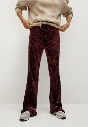 MARTA - Trousers - granatrot