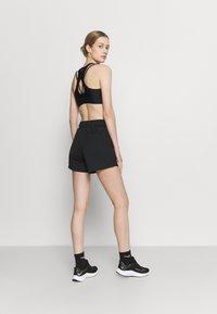 Nike Performance - SHORT PLUS - Pantalón corto de deporte - black/white - 2