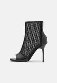 River Island - Kotníková obuv na vysokém podpatku - black - 1