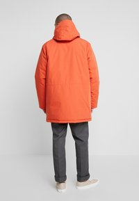 Carhartt WIP - TROPPER - Wintermantel - brick orange