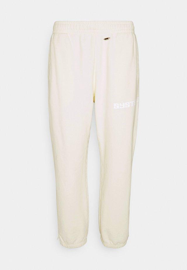 GLOW IN THE DARK PANTS - Teplákové kalhoty - natural white