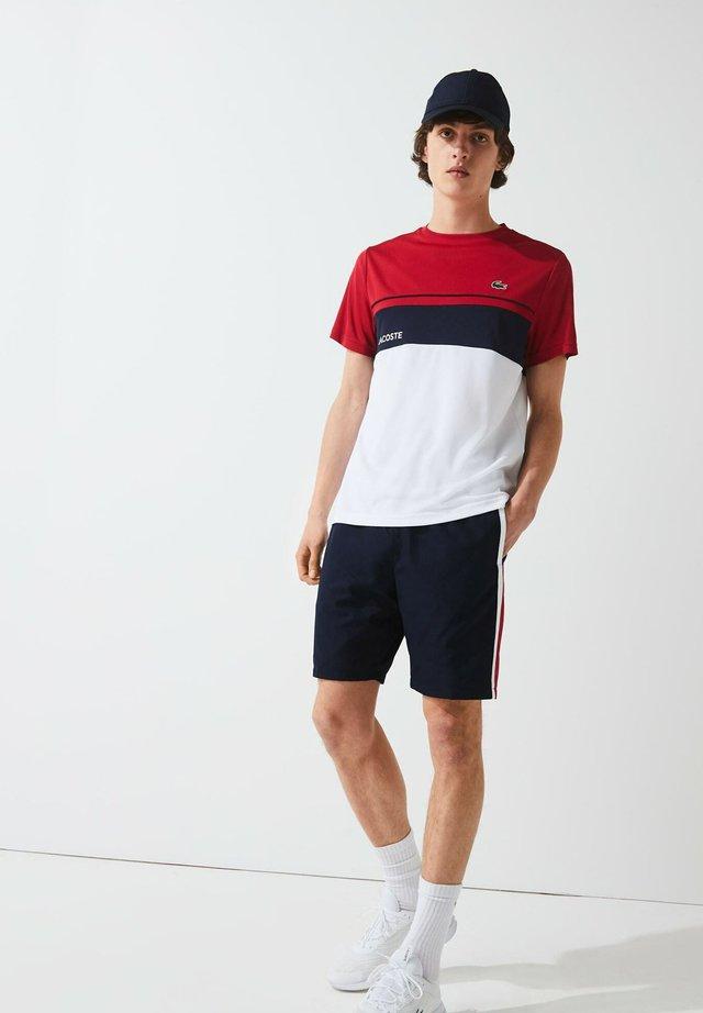 HOMME - Short de sport - bleu marine / rouge / blanc