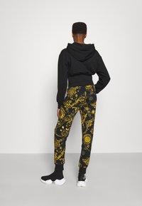 Versace Jeans Couture - PANTS - Tracksuit bottoms - black/gold - 2