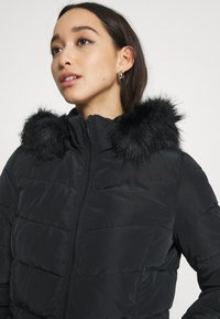 ONLY - ONLNEWMINEA QUILTED HOOD COAT - Parka - black - 4