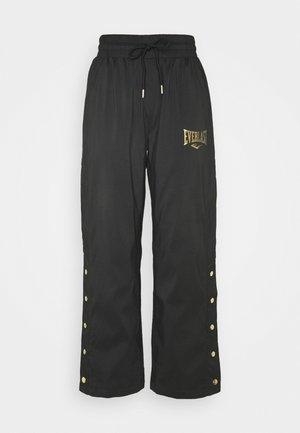 WOVEN PANT LOWEL - Teplákové kalhoty - black