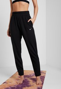 Nike Performance - FLOW PANT - Tracksuit bottoms - black/white - 0